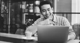 Man reviwing taxes on laptop