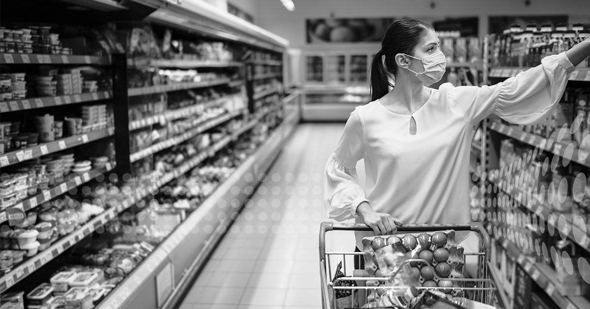 Woman shopping with mask during pandemic