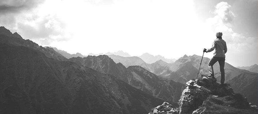 Man on a mountain overlooking the alternative