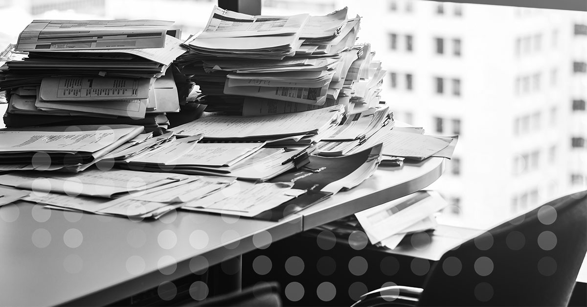 Administrators desk covered in paperwork