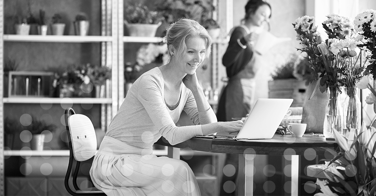 Woman smiling while reading computer