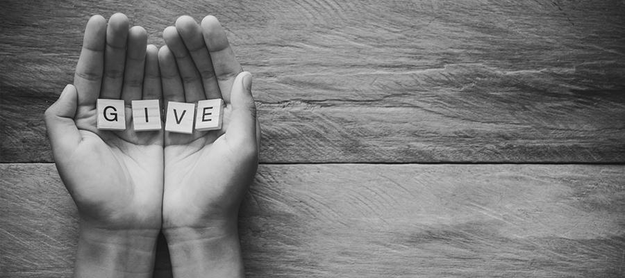Hands giving back