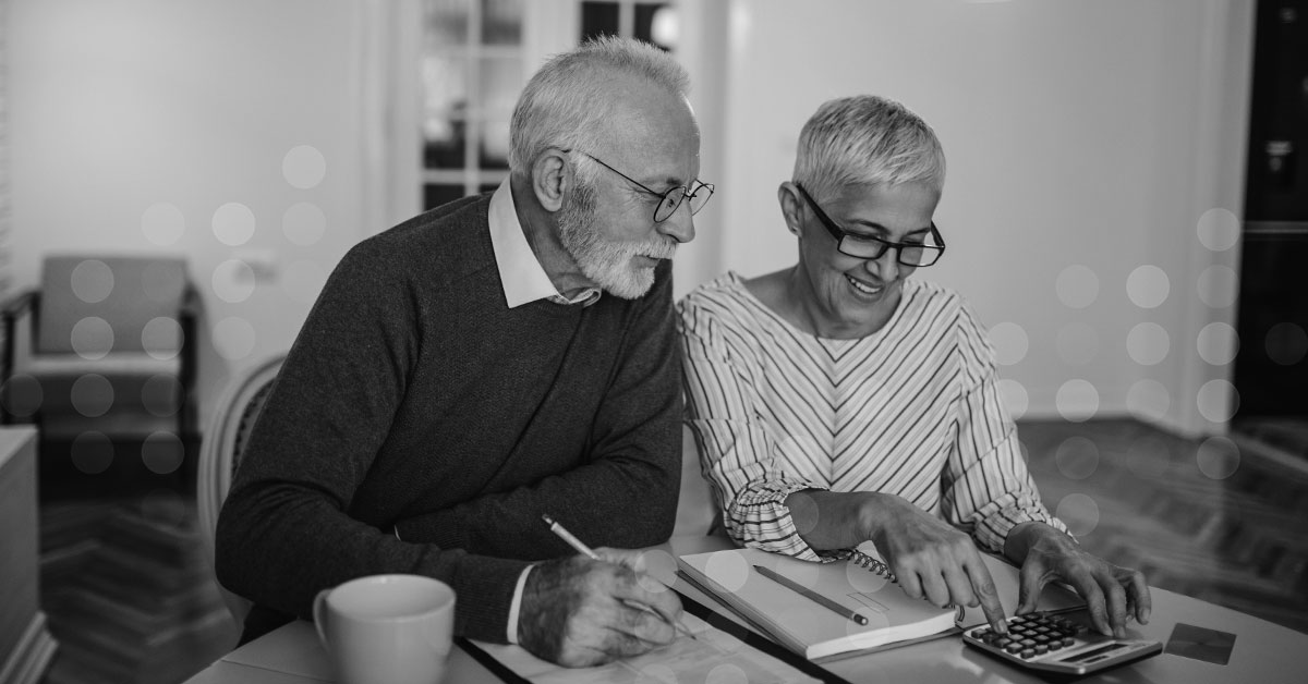Retired couple reviewing financial calculations