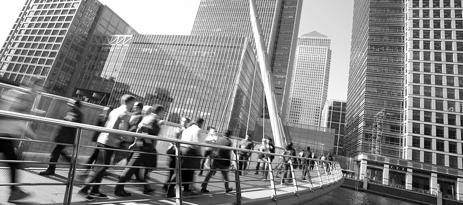 people crossing a bridge to go to work